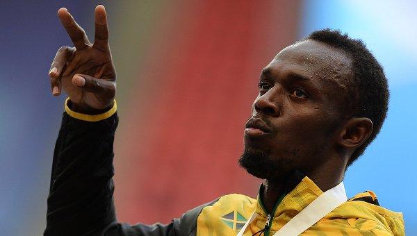 Усэйн Болт (Ямайка), завоевавший золотую медаль в забеге на 200 м