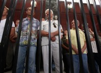 Граждане разных стран, осужденные за пособничество войскам Каддафи в здании суда в Триполи, Ливия