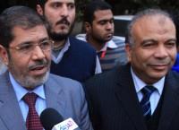 Мухаммед Мурси и Мухаммед аль-Кататни (справа). Архив