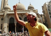 Сторонник свергнутого президента Египта Мурси о время акции протеста в Каире